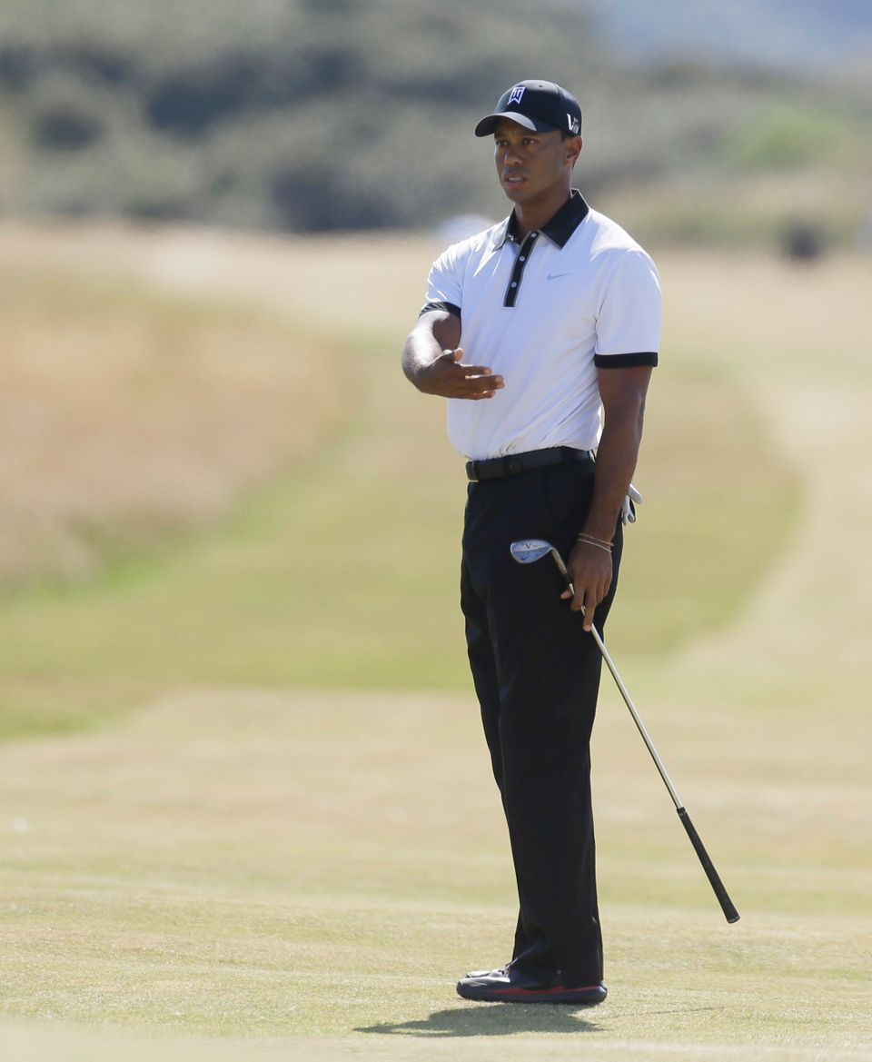 Tiger Woods of the United States gestures on the 6th fairway during the first round of the British Open Golf Championship at