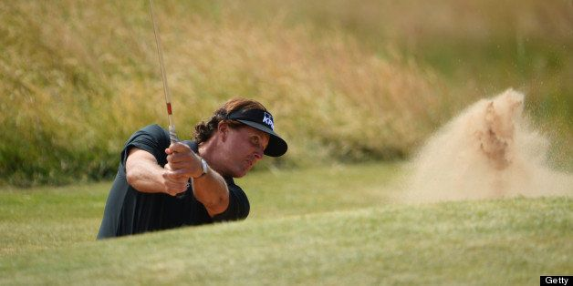 GULLANE, SCOTLAND - JULY 18:  Phil Mickelson of the United States hits out of a bunker on the 13th hole during the first roun