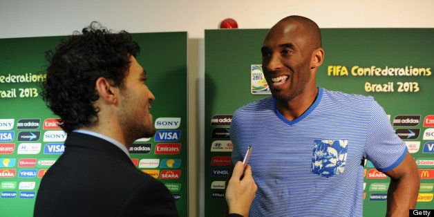 SALVADOR, BRAZIL - JUNE 22:  LA Lakers basketball star Kobe Bryant is interviewed prior to the FIFA Confederations Cup Brazil