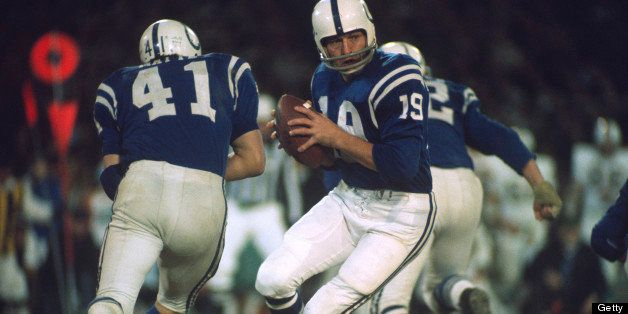 BALTIMORE, MD - DECEMBER 11:  Quarterback Johnny Unitas #19 of the Baltimore Colts rolls out to pass against the Miami Dolphi