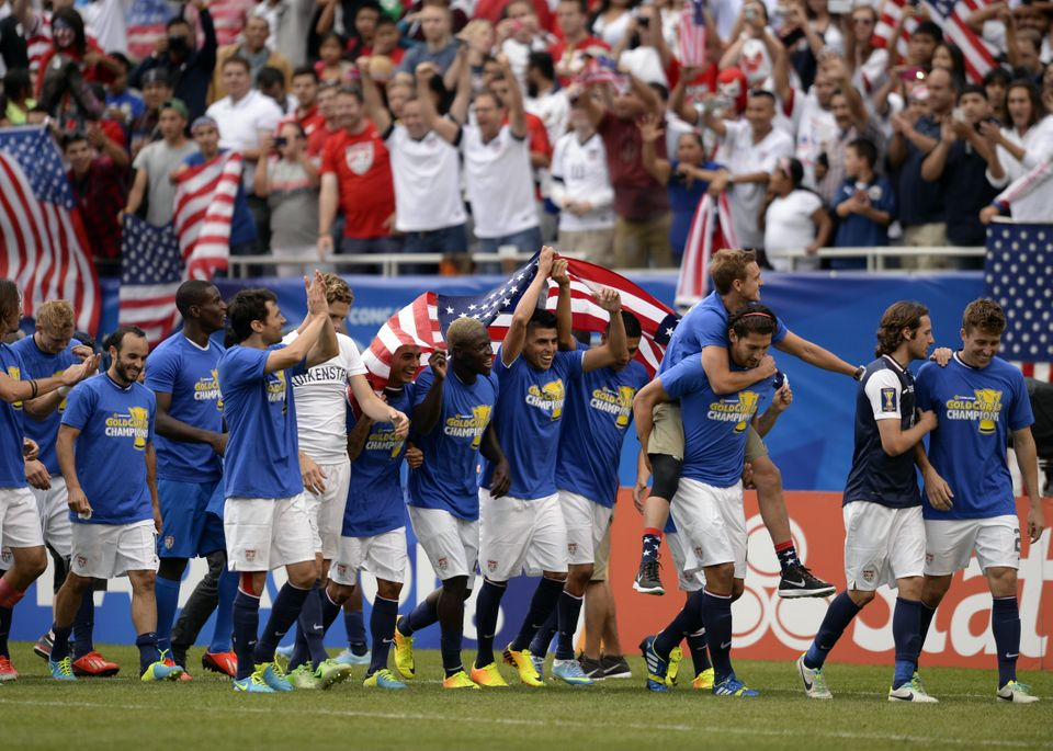US players celebrate after defeating Panama 1-0  in the CONCACAF Gold Cup final on July 28, 2013 at Soldier Field in Chicago.
