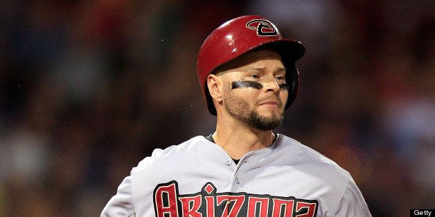 BOSTON, MA - AUGUST 2: Cody Ross #7 of the Arizona Diamondbacks runs down the first base line after grounding out to the shor