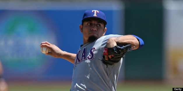 OAKLAND, CA - AUGUST 3:  Matt Garza #22 of the Texas Rangers pitches against the Oakland Athletics during the game at O.co Co