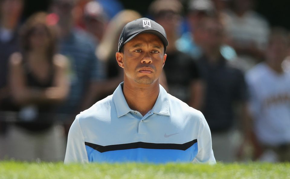 ROCHESTER, NY - AUGUST 08:  Tiger Woods of the United States reacts to a bunker shot on the fourth hole during the first roun