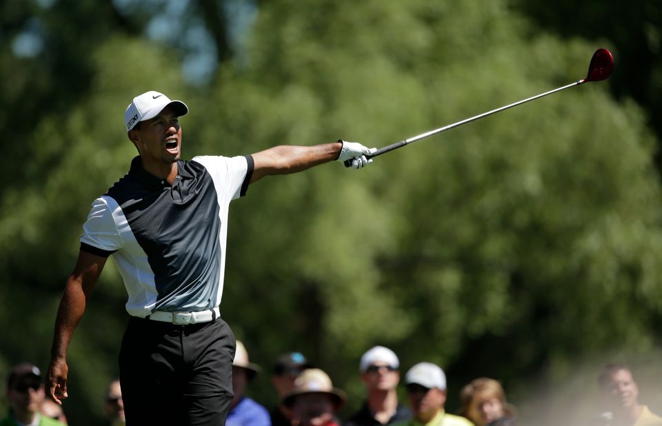 Tiger Woods reacts after his drive went left on the ninth hole during the third round of the PGA Championship golf tournament