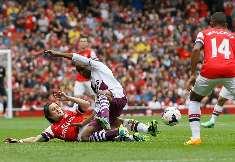 Arsenal's Tomas Rosicky, below, vies for the ball with Aston Villa's Karim El Ahmadi during the English Premier League soccer