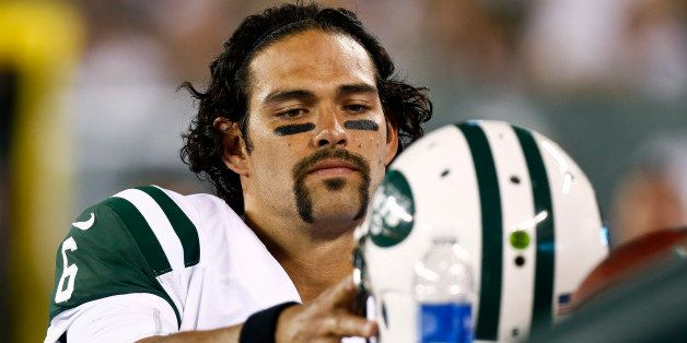 EAST RUTHERFORD, NJ - AUGUST 17:   Mark Sanchez #6 of the New York Jets puts his hemet on the bench during their preseason ga
