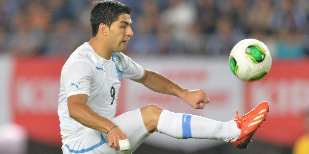Uruguay's forward Luis Suarez attempts a shot against Japan during their international friendly football match at Miyagi Stad