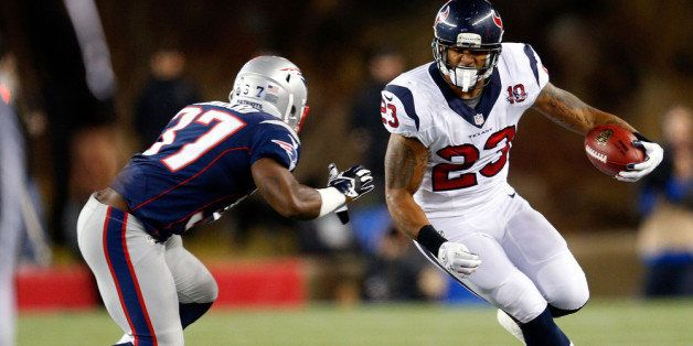 FOXBORO, MA - JANUARY 13:  Arian Foster #23 of the Houston Texans runs with the ball against Alfonzo Dennard #37 of the New E