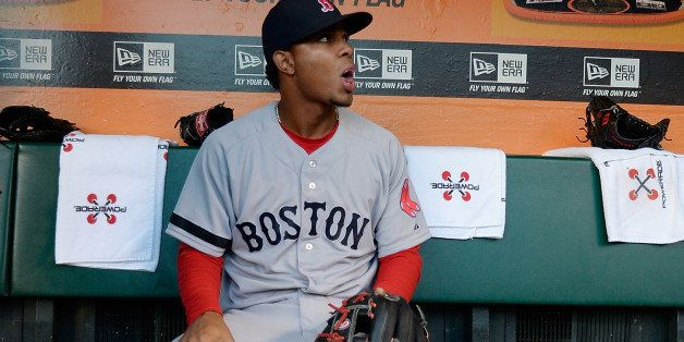 SAN FRANCISCO, CA - AUGUST 20:  Xander Bogaerts #72 of the Boston Red Sox looks on from the dugout prior to the start of his