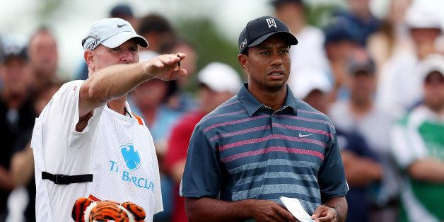 JERSEY CITY, NJ - AUGUST 23: Tiger Woods of the United States speaks with his caddie, Joe LaCava, on the second tee during th
