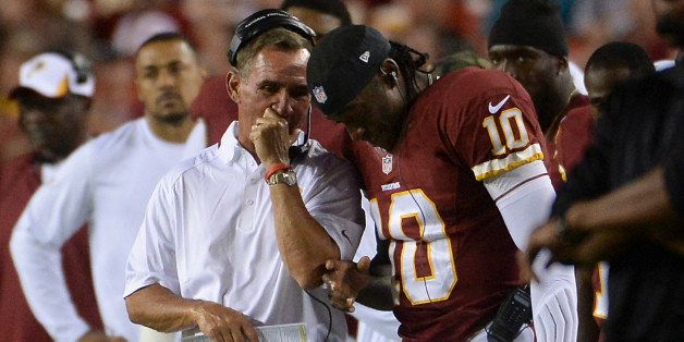LANDOVER - AUGUST 19: Washington Redskins head coach Mike Shanahan talks with Washington Redskins quarterback Robert Griffin