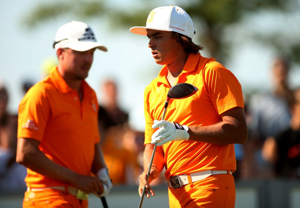 JERSEY CITY, NJ - AUGUST 25:  Rickie Fowler of the United States (R) and Jonas Blixt of Sweden (L) stand on the 13th tee duri