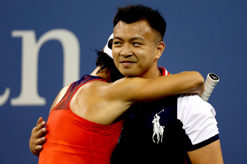 NEW YORK, NY - AUGUST 26:  Francesca Schiavone of Italy hugs a ball boy during her first round women's singles match against