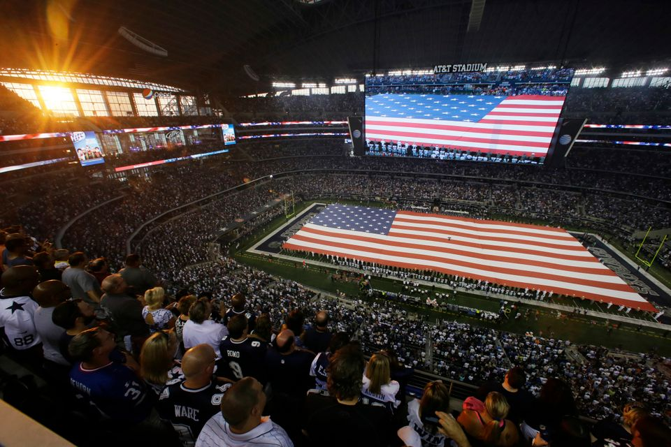 The U.S. national anthem is played at AT&T Stadium before an NFL football game between the Dallas Cowboys and the New York Gi