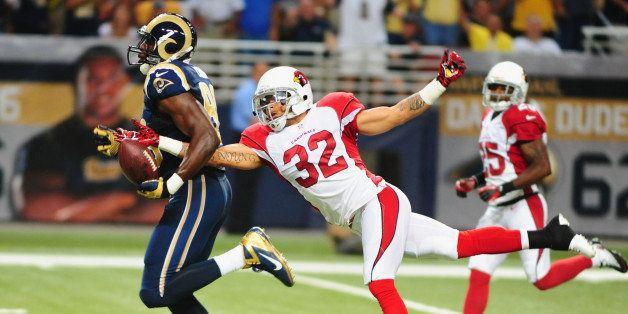 ST. LOUIS, MO - SEPTEMBER 8: Safety Tyrann Mathieu #32 of the Arizona Cardinals strips the ball from tight end Jared Cook #89