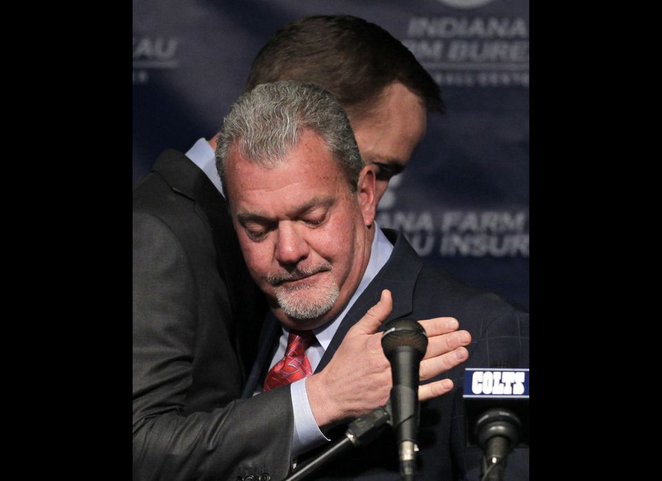 Indianapolis Colts owner Jim Irsay, front, hugs quarterback Peyton Manning after announcing that the NFL football team will r