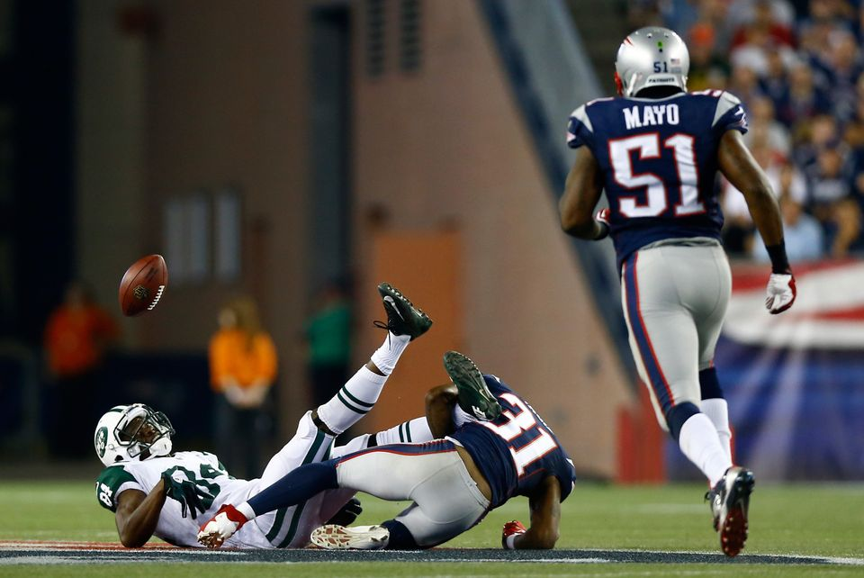 FOXBORO, MA - SEPTEMBER 12:  Wide receiver Stephen Hill #84 of the New York Jets fumbles in the first quarter as he is hit by