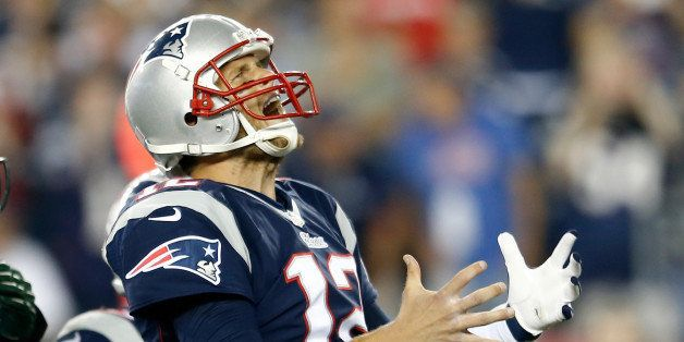 FOXBORO, MA - SEPTEMBER 12:  Quarterback Tom Brady #12 of the New England Patriots reacts after an incomplete pass in the sec