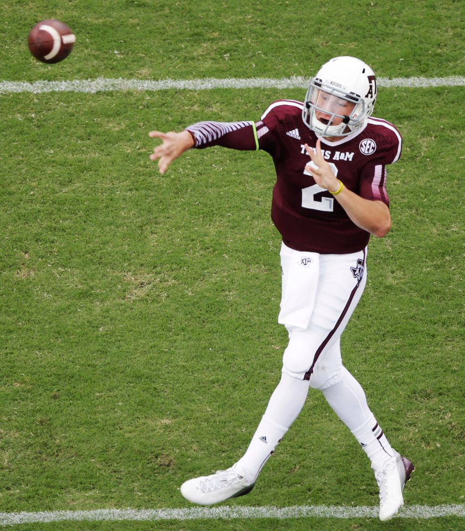 Texas A&M quarterback Johnny Manziel (2) passes against Alabama during the first quarter of an NCAA college football game Sat
