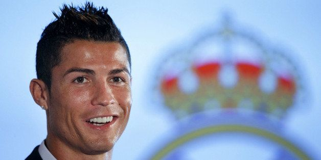 MADRID, SPAIN - SEPTEMBER 15:  Cristiano Ronaldo speaks to the media after signing a contract renewal for Real Madrid at Esta