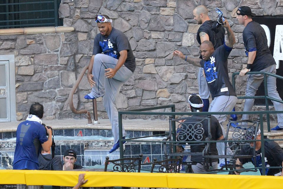 PHOENIX, AZ - SEPTEMBER 19:  Los Angeles Dodgers players jump in the pool after clinching the National League West after a 7-