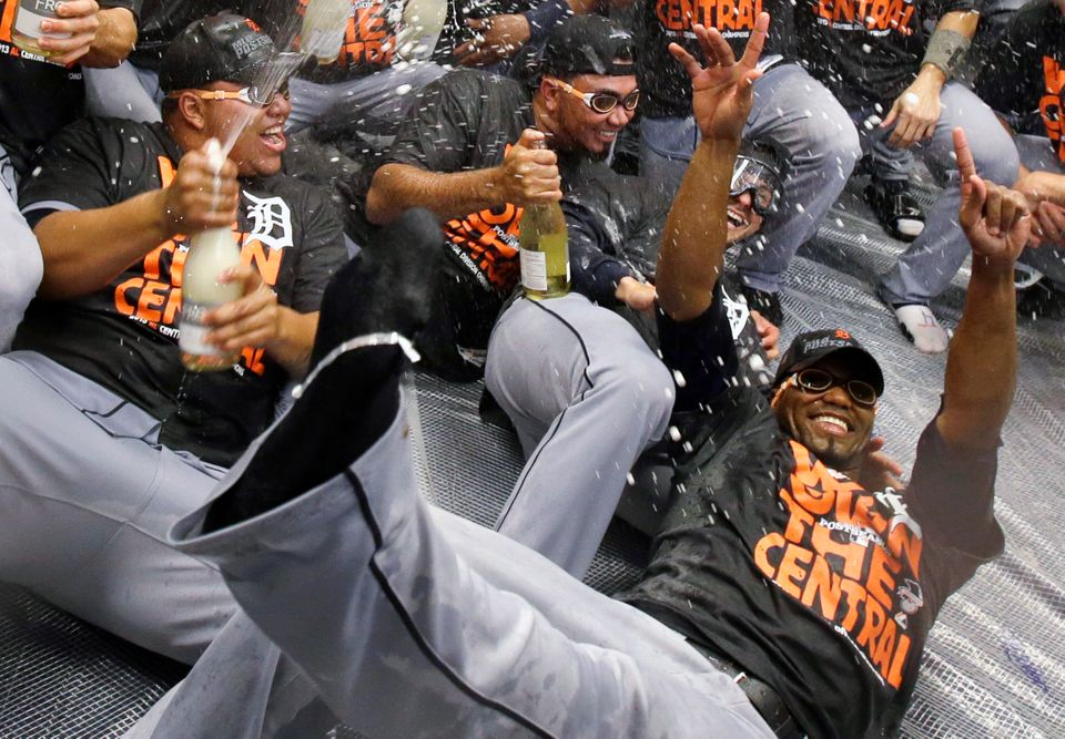 Detroit Tigers pitchers Bruce Rondon, left, Joaquin Benoit, center and Al Alburquerque, right, celebrate after the Tigers won