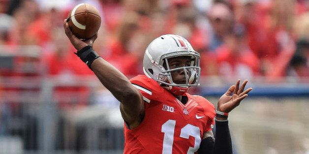 COLUMBUS, OH - SEPTEMBER 21:  Kenny Guiton #13 of the Ohio State Buckeyes passes against the Florida A&M Rattlers at Ohio Sta