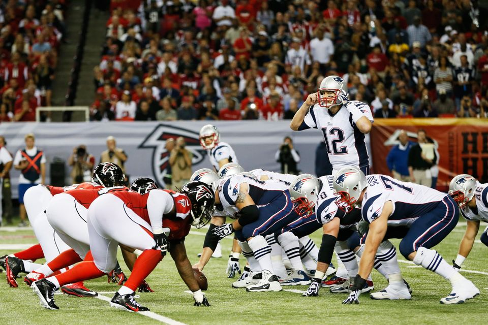 ATLANTA, GA - SEPTEMBER 29:  Tom Brady #12 of the New England Patriots calls a play against the Atlanta Falcons during the ga
