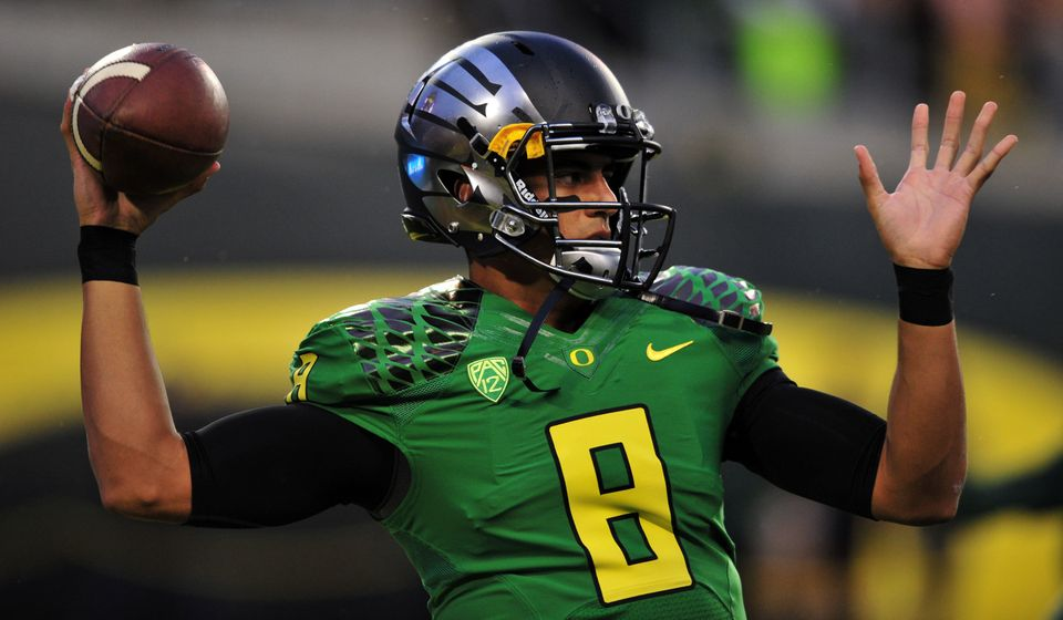 The leader of the Ducks' up-tempo, high-octane offense withstood driving rain to toss two touchdowns and run for another in a