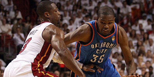 Miami Heat's Dwyane Wade guards Oklahoma City Thunder's Kevin Durant in the second quarter during Game 3 of the NBA Finals at