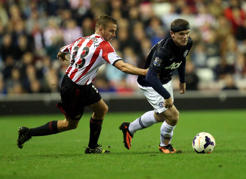 Manchester United's Wayne Rooney, right, vies for the ball with Sunderland's Lee Cattermole during their English Premier Leag