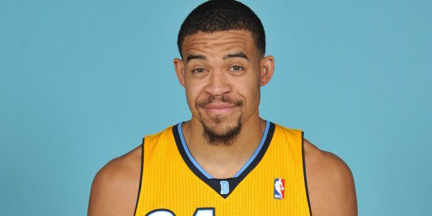 DENVER, CO - SEPTEMBER 30:  JaVale McGee #34 of the Denver Nuggets poses for a picture during Media Day on September 30, 2013
