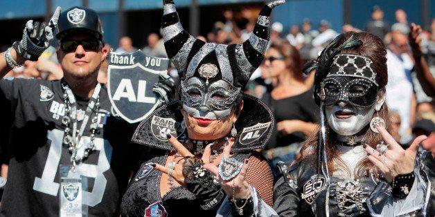 OAKLAND, CA - SEPTEMBER 15:  Oakland Raiders fans cheer on their team against the Jacksonville Jaguars on September 15, 2013