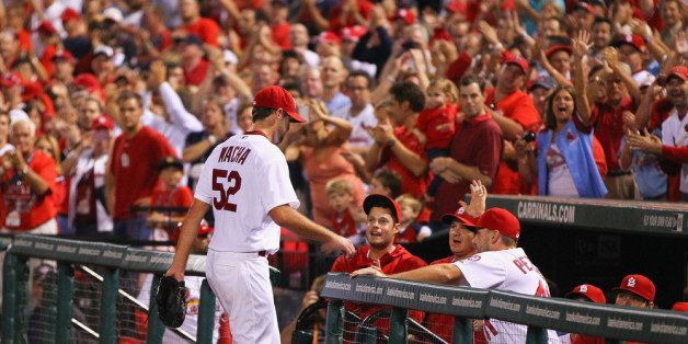 ST. LOUIS, MO - SEPTEMBER 24:  Starting pitcher  Michael Wacha #52 of the St. Louis Cardinals is congratulated by fans and te