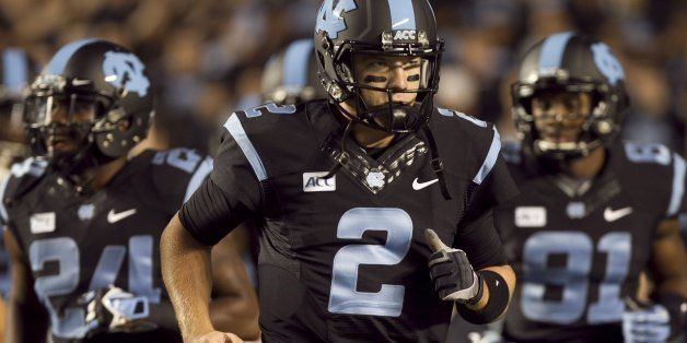 North Carolina quarterback Bryn Renner (2) leads his teammates onto the  field against Miami 9a48385b0