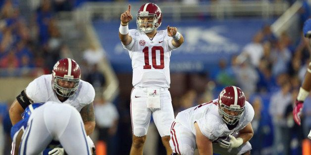 LEXINGTON, KY - OCTOBER 12:  A J McCarron #10 of the Alabama Crimson Tide gives instructions to his team during the game agai