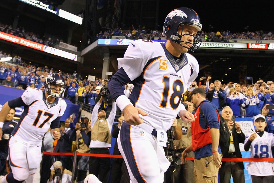 INDIANAPOLIS, IN - OCTOBER 20: Peyton Manning #18 of the Denver Broncos takes the field for warm-ups prior to playing against