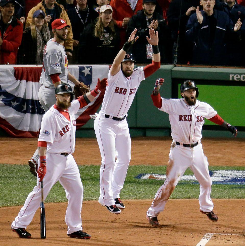 St. Louis Cardinals starting pitcher Adam Wainwright, left, rear watches as Boston Red Sox's Jonny Gomes, left, Jacoby Ellsbu