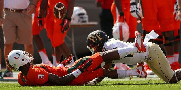 MIAMI GARDENS, FL - OCTOBER 26:  Stacy Coley #3 of the Miami Hurricanes makes a catch against Merrill Noel #7 of the Wake For