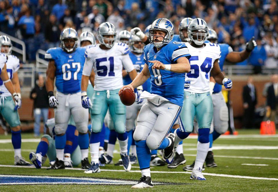 Detroit Lions quarterback Matthew Stafford (9) celebrates scoring on a 1-yard touchdown run against the Dallas Cowboys in the