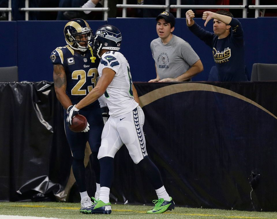 Seattle Seahawks wide receiver Golden Tate (81) speaks with St. Louis Rams free safety Rodney McLeod (23) after Tate scored a