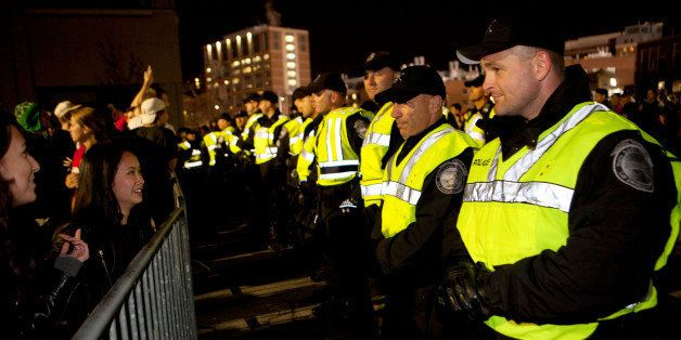 BOSTON, MA - OCTOBER 30: Boston Police line up along a barrier securing the area around Fenway Park after the Boston Red Sox