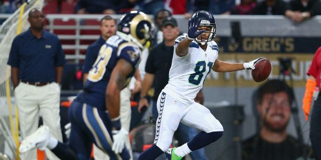 ST LOUIS, MO - OCTOBER 28:  Golden Tate #81 of the Seattle Seahawks celebrates as he runs for a touchdown during the 14-9 vic