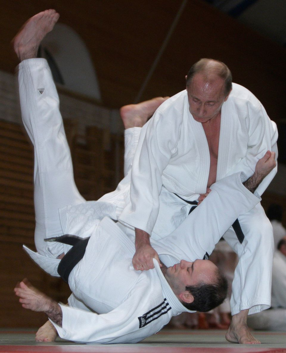 In this Friday, Dec. 18, 2009 file photo, then Russian prime minister Vladimir Putin, right, is seen during judo training at