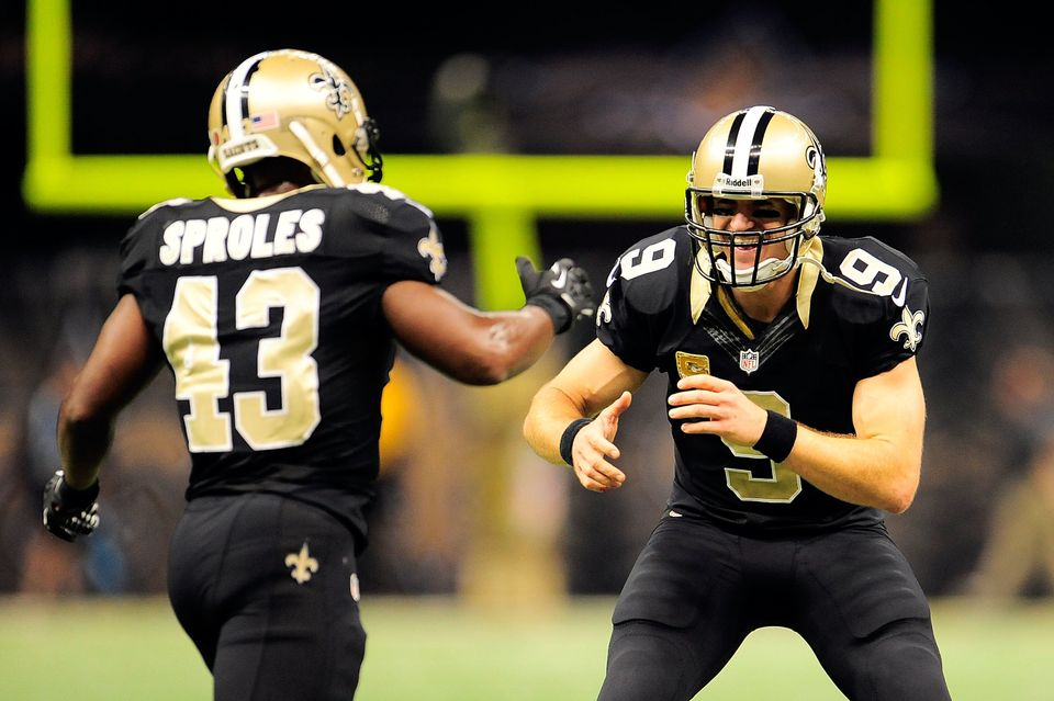 NEW ORLEANS, LA - NOVEMBER 10:  Drew Brees #9 of the New Orleans Saints congratulates Darren Sproles #43 following a touchdow