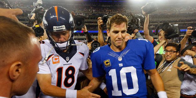 EAST RUTHERFORD, NJ - SEPTEMBER 15:  (NEW YORK DAILIES OUT)   Quarterbacks Peyton Manning #18 of the Denver Broncos and Eli M