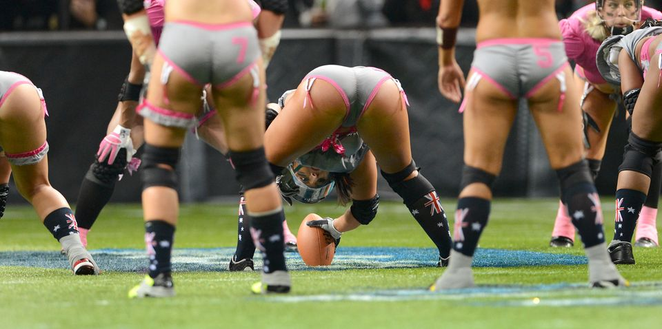 A Western conference player prepares to pass the ball back against the Eastern Conference team during their Lingerie Football