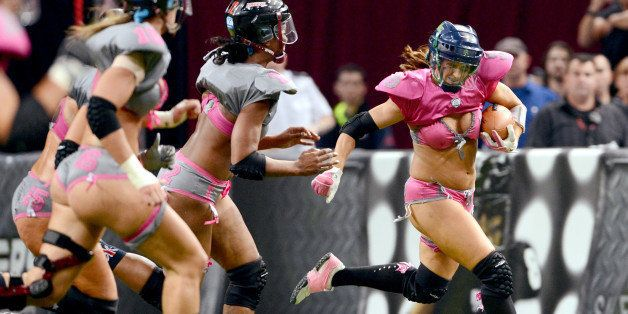 Western confernce player Jessica Hopkins (R) makes a break against the Eastern Conference players during their Lingerie Footb