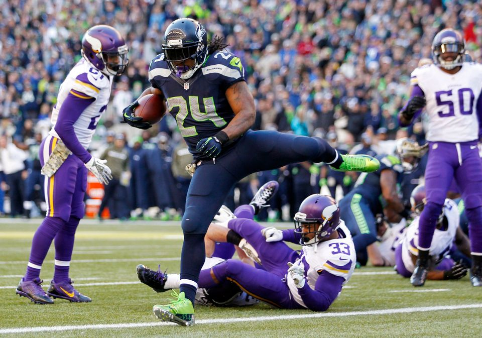Seattle Seahawks' Marshawn Lynch (24) scores against Minnesota Vikings in the first half of an NFL football game Sunday, Nov.